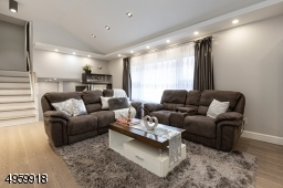 with high ceiling, recess lighting,build in  speakers and wired for electric blinds/shades