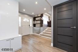 with heated floor , custom large coat closet
