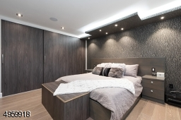 with dropped ceiling , recess lights, large custom closet and build in speakers