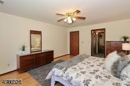 Large closet, adjacent sitting room and full bath