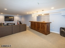 29' rec room with wall to wall carpeting and built in bar