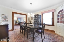 Formal dining room with built-in corner china cabinet - perfect for entertaining with great flow from kitchen and living room