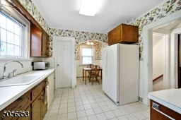 Kitchen with breakfast nook and powder room