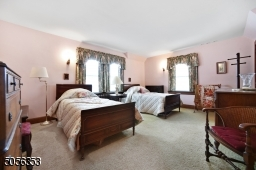 Generous primary bedroom with 2 closets and ample natural light