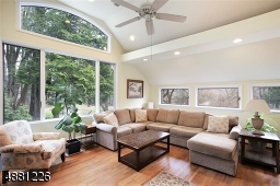 Warm & Inviting room with high volume ceiling