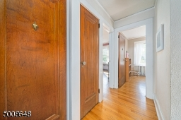 Solid Wood Doors in Pristine Condition with Original Glass Door knobs throughout the home