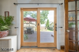 Lots of natural light flood the Dining Room through these Sliding Doors.