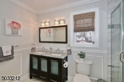 There is a double vanity, large stall shower & linen closet.