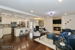 Gleaming hardwood floors , recessed lighting, box beam ceiling and electric fireplace with heat fan.