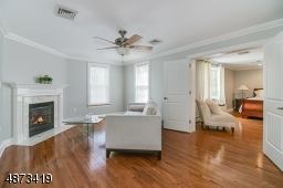 Located adjacent to the MBR, this Sitting Room features a gas fireplace, hardwood floor; freshly painted.  Accessible thru both MBR, as well as hallway