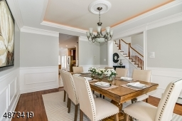 Dining Room is conveniently located adjacent to Kitchen; generously sized to accommodate a large dinner party