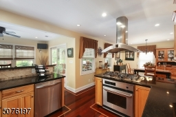 SS Appliances, granite counter tops, SS Exhaust Hood over Gas cook top. Convection/electric Oven