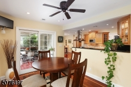Kitchen w separate dining area opens to deck with view of Huge back yard, patio and Inground Pool