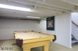 Lower Level: Large Rec Rm.  Separate Playing Pool area, Laundry, Tile Floor   NOT INC: Pool Table, W/D