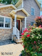 Beautiful Flowers surround entry way to Front Door