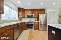 LG stainless steel appliances, cherry cabinets