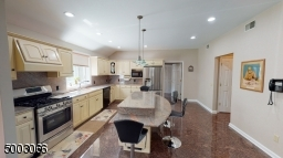 Full View of the Kitchen with Granite Floors and Countertops