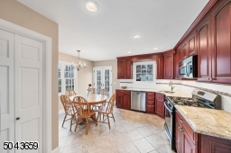 The kitchen was new in 2012. It is cherry wood with granite counters and stainless steel appliances. There is a walk in pantry.
