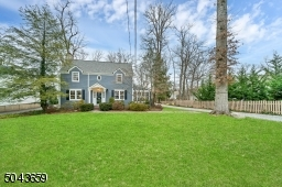 There is a charming stone driveway. There is a one car garage. The rear yard is level and great for any outdoor activities.