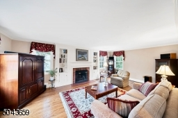 The front to back living room is sunny and bright throughout the day. There is a wood burning fireplace flanked by built-ins.