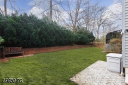 Beautiful Backyard with Flower Planting Bed & Evergreen Trees!