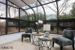 Glass Enclosed, Heated & Air Conditioned 4-Season Sunroom.