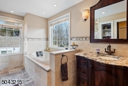 Jetted tub, glass enclosed stall shower, vanity. All bathrooms have their own thermostat.