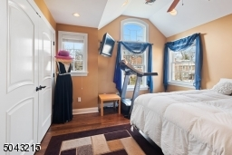 One of 3 additional second floor bedrooms.