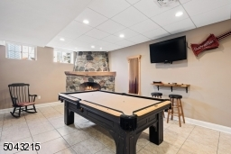 Lower level family room/game room with gas fireplace.