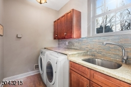 First floor laundry conveniently located just off garage and mud room.