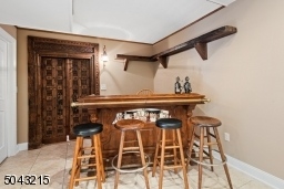 This lower level has everything you want for entertaining. Those fantastic doors lead to the wine tasting room