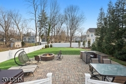 Fully fenced with a beautiful patio and summer kitchen. Hot tub negotiable