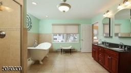 luxury bathroom with soaking tub,
