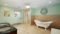 luxury bathroom , spray shower and dual vanity.