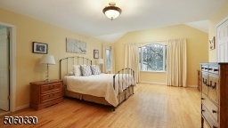Primary bedroom suite with cathedral ceilings, recessed lighting, two walk-in closets