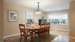 Formal dining room with a picture window.