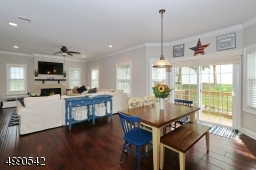 Kitchen opens to family room area with Gas Fireplace