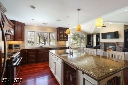 Gourmet Kitchen with top appliances and large center island with beverage cooler.