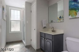 Full bath with stall shower in the finished, walk-out ground level.
