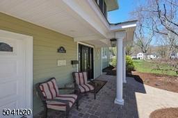 A beautiful paver patio wraps around the home.