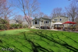 Professionally landscaped property with a putting green, storage shed, patio and new gazebo.