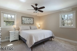 Freshly painted Master Bedroom with ceiling fan and 2 closets.