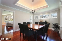 Dining Room with tray ceiling and decorative moldings.