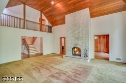 This amazing fireplace is 2-sided and look at that hallway to the 2nd floor!