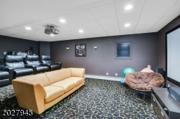"""24'6""""x 15'10"""" Recessed lighting, 4 up light wall sconces, multi-level JVC Hi Definition Projector/ 120"""" projection screen, full surround sound, DVD/Xbox, Satellite TV & WiFi System, 4 leather recliners/built-in food trays"""