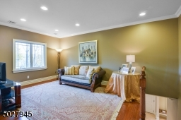 """15' 4"""" x 11' 8"""" Private staircase from Mudroom, crown moulding, recessed lighting, white oak flooring"""